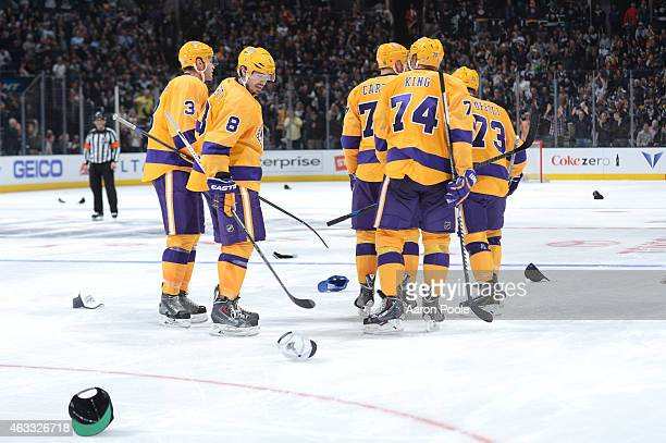 Members of the Los Angeles Kings including Brayden McNabb Drew Doughty Jeff Carter Dwight King and Tyler Toffoli of the Los Angeles Kings stand on...