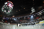 Members of the Los Angeles Kings look on as the championship banner is raised before the NHL season opener at STAPLES Center on September 8 2014 in...