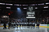 Members of the Los Angeles Kings look on as the Stanley Cup is lowered to the ice before the NHL Season opener at STAPLES Center on September 8 2014...