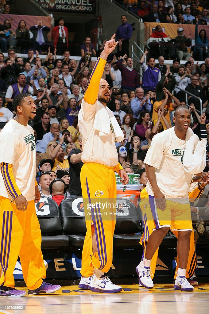 Members of the Los Angeles Lakers cheer from the bench against the New Orleans Hornets at Staples Center on April 9, 2013 in Los Angeles, California.