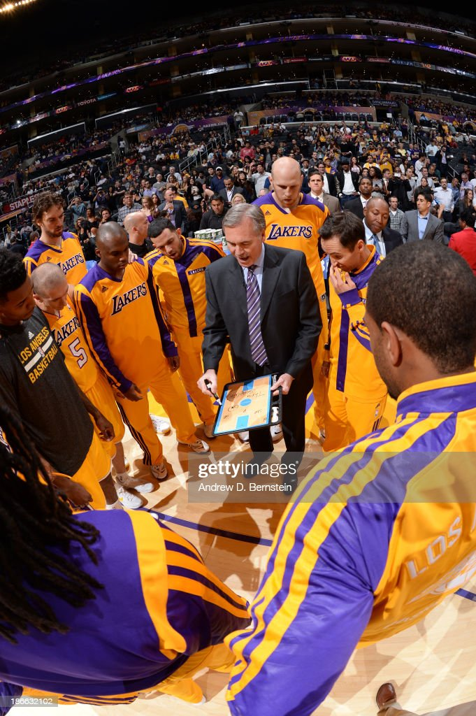 Members of the Los Angeles Lakers huddle before a game against the San Antonio Spurs on November 1, 2013 at STAPLES Center in Los Angeles, California.