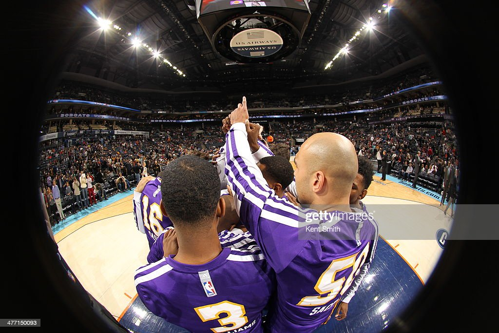 Members of the Los Angeles Lakers look on against the Charlotte Bobcats during the game at the Time Warner Cable Arena on December 14, 2013 in Charlotte, North Carolina.