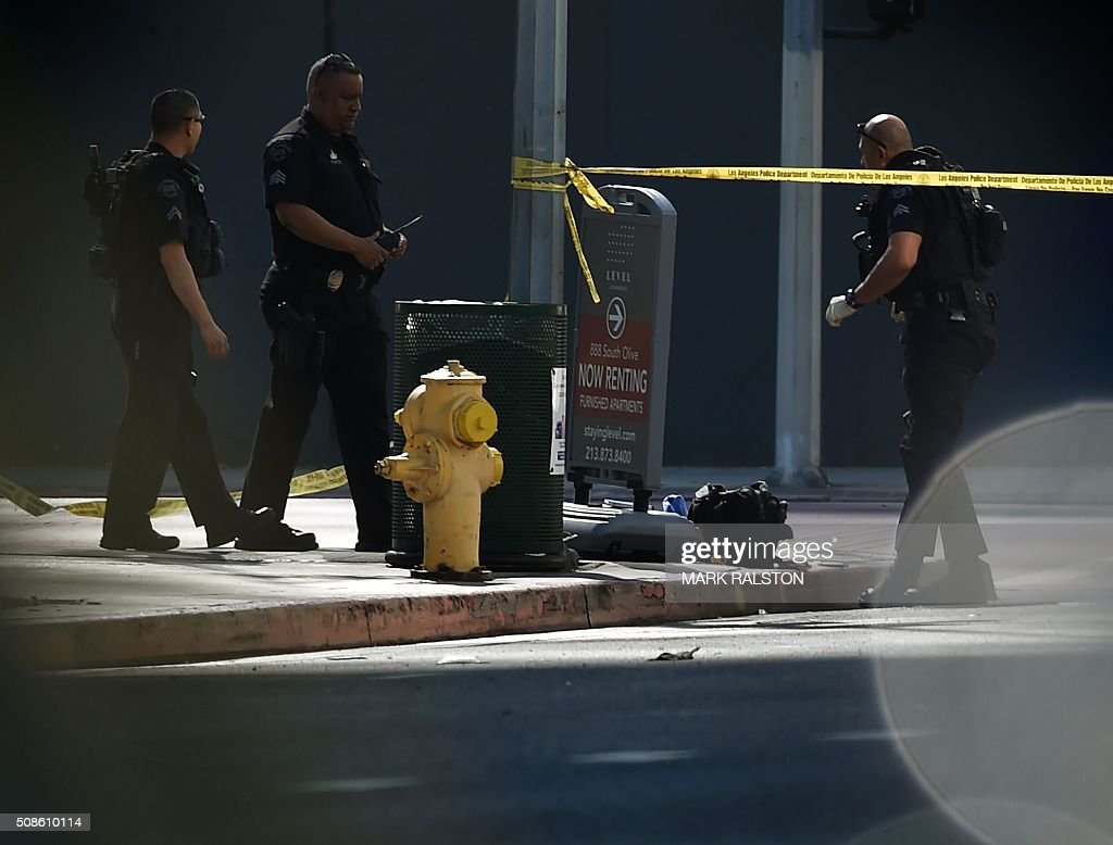 Members of the Los Angeles Police Department (LAPD) bomb squad investigate a suspicious package left outside a downtown Starbucks as the city stays on alert after the recent San Bernadino terrorist...