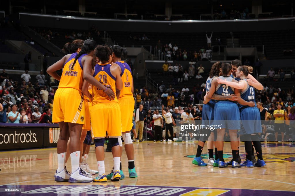 Members of the Los Angeles Sparks and members of the Minnesota Lynx huddle during a game at Staples Center on September 12, 2013 in Los Angeles, California.