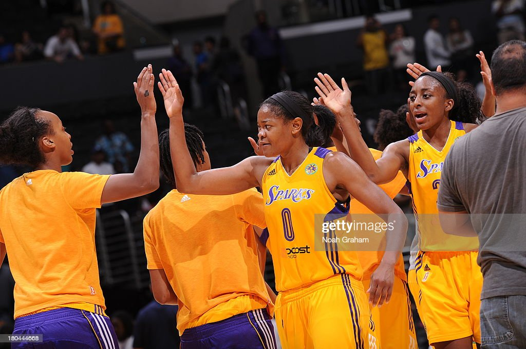 Members of the Los Angeles Sparks high five during a game against the Minnesota Lynx at Staples Center on September 12, 2013 in Los Angeles, California.
