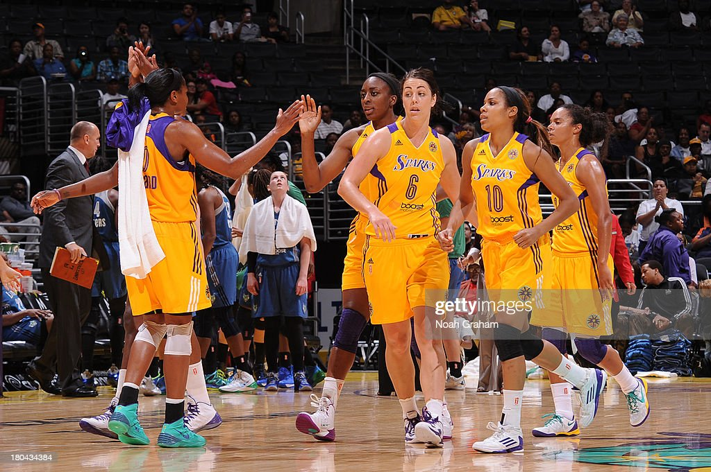 Members of the Los Angeles Sparks high-five during a game against the Minnesota Lynx at Staples Center on September 12, 2013 in Los Angeles, California.