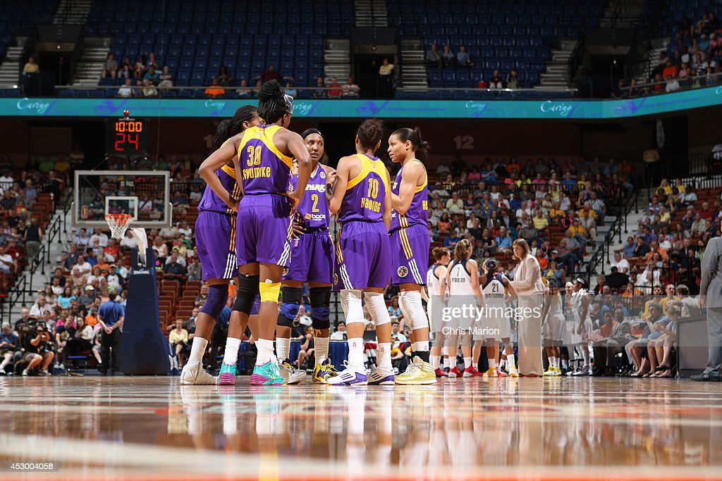 Members of the Los Angeles Sparks huddle during the game against the Connecticut Sun at the Mohegan Sun Arena on July 13, 2014 in Uncasville, Connecticut.