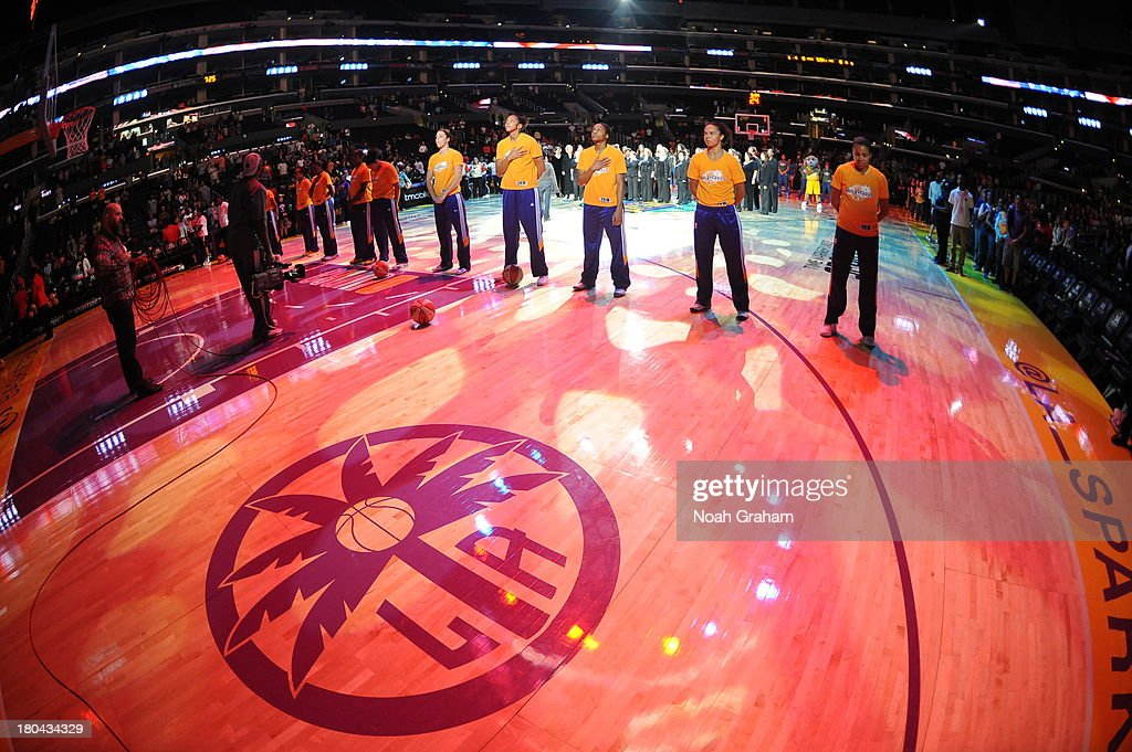 Members of the Los Angeles Sparks stand in observance of the national anthem before a game against the Minnesota Lynx at Staples Center on September 12, 2013 in Los Angeles, California.