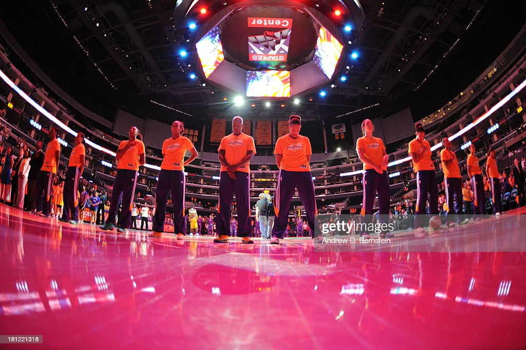 Members of the Los Angeles Sparks stand in observance of the national anthem prior to a game against the Phoenix Mercury at STAPLES Center on September 19, 2013 in Los Angeles, California.