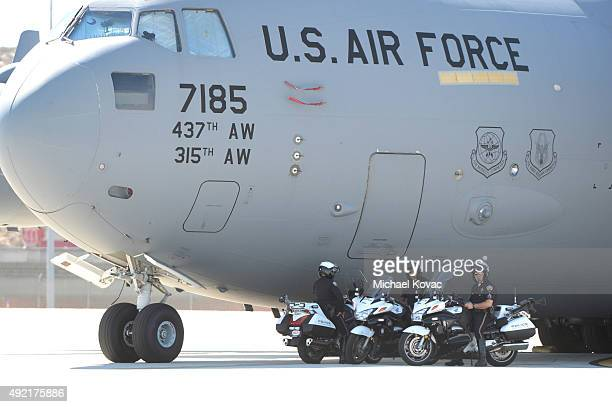 Members of the Los Angeles World Airport Police stand by a US Air Force Boeing C17 at LAX Airport on October 10 2015 in Los Angeles California