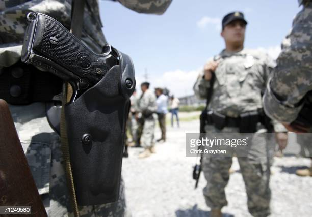 Members of the Louisiana National Guard gather outside the Ernest N Morial Convention Center on June 20 2006 in New Orleans Louisiana About...