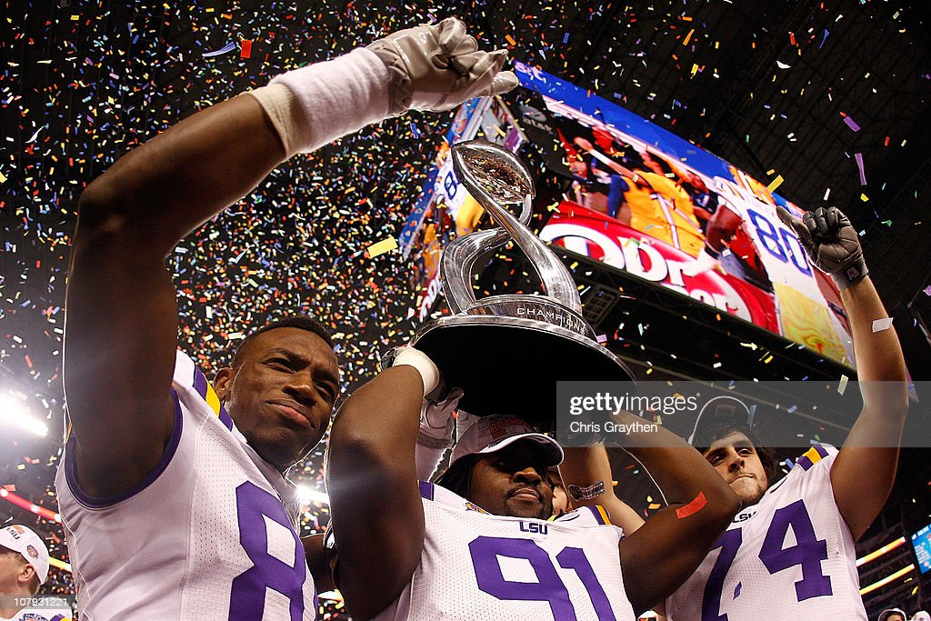 Members of the Louisiana State University Tigers celebrate after defeating the Texas A&M Aggies 41-24 during the AT&T Cotton Bowl at Cowboys Stadium on January 7, 2011 in Arlington, Texas.