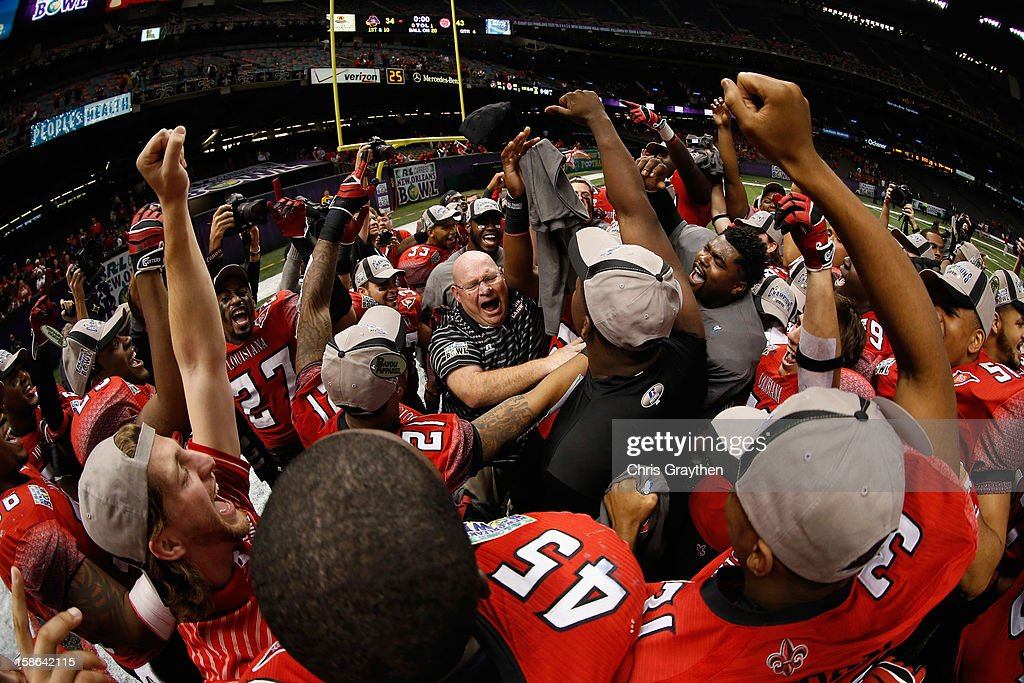Members of the Louisiana-Lafayette Ragin Cajuns celebrate after defeating the East Carolina Pirates during the R+L Carriers New Orleans Bow at the Mercedes-Benz Superdome on December 22, 2012 in New Orleans, Louisiana.