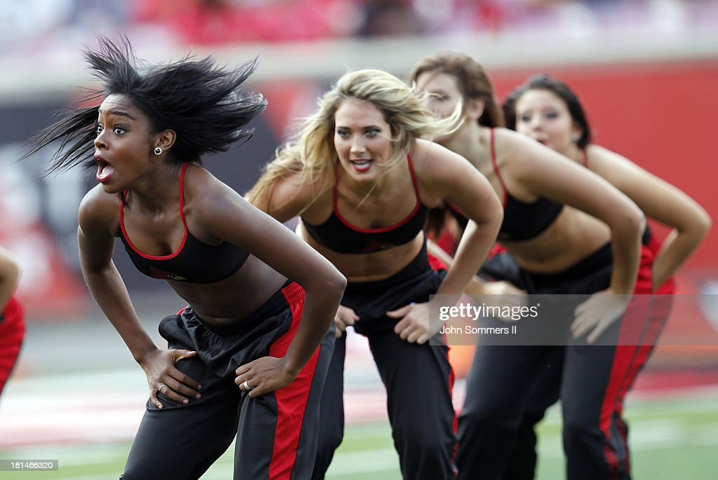Members of the Louisville Cardinals dance team cheer for their team against the Florida International Panthers at Papa John's Cardinal Stadium on September 21, 2013 in Louisville, Kentucky.