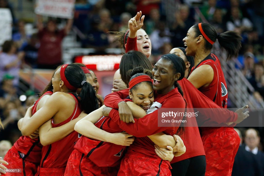 Members of the Louisville Cardnials celebrate after defeating the California Golden Bears 64-57 to advance to the final roundduring the National Semifinal game of the 2013 NCAA Division I Women's Basketball Championship at the New Orleans Arena on April 7, 2013 in New Orleans, Louisiana.