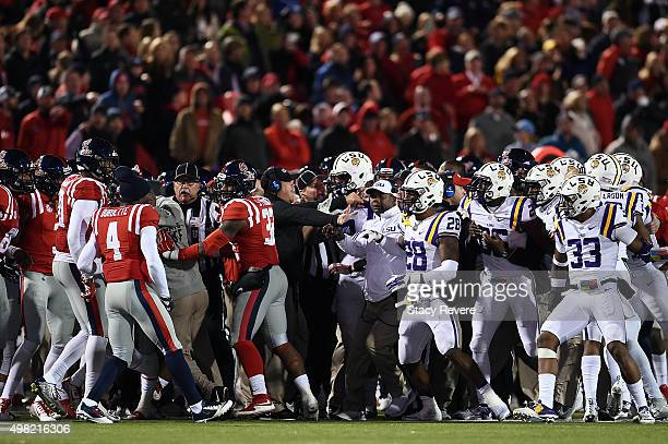 Members of the LSU Tigers and the Mississippi Rebels had to be separated during the second half of a game at VaughtHemingway Stadium on November 21...