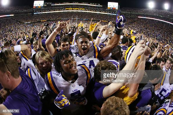 Members of the LSU Tigers celebrate after defeating the Mississippi Rebels 107 at Tiger Stadium on October 25 2014 in Baton Rouge Louisiana