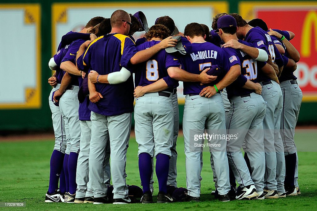 Members of the LSU Tigers gather in the outfield prior to game 2 of the NCAA baseball Super Regionals against the Oklahoma Sooners at Alex Box Stadium on June 8, 2013 in Baton Rouge, Louisiana.