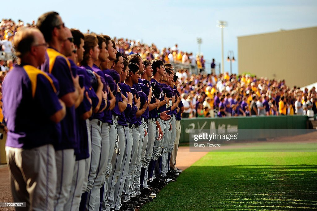 Members of the LSU Tigers stand for the National Anthem prior to game 2 of the NCAA baseball Super Regionals against the Oklahoma Sooners at Alex Box Stadium on June 8, 2013 in Baton Rouge, Louisiana.