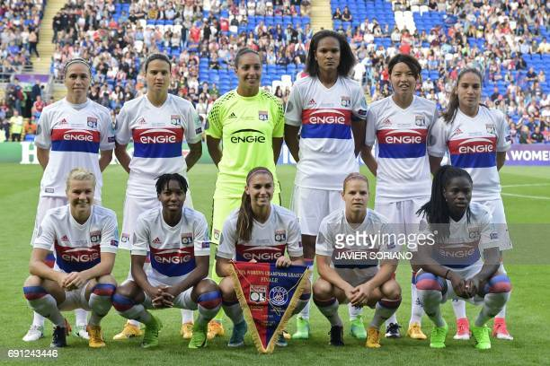 Members of the Lyon women's football team pose for a photograph prior to the UEFA Women's Champions League final football match between Lyon and...