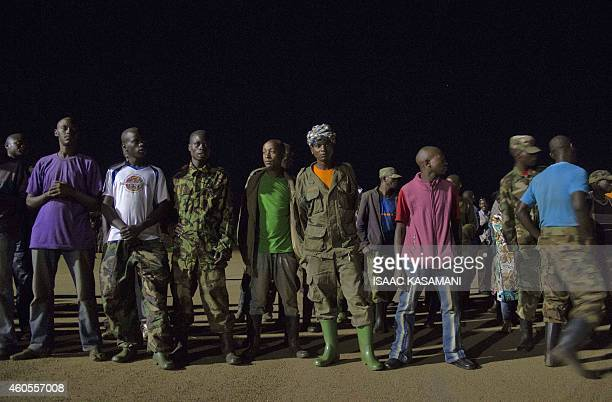 Members of the M23 rebel group wait to be flown to the Democratic Republic of Congo as part of a handover to the DRC government at Ugandas army...