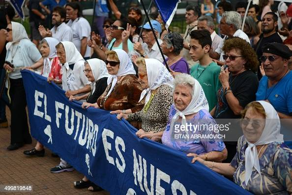 Members of the Madres de Plaza de Mayo human rights organization take part in the traditional round which they have been holding for the past 38...