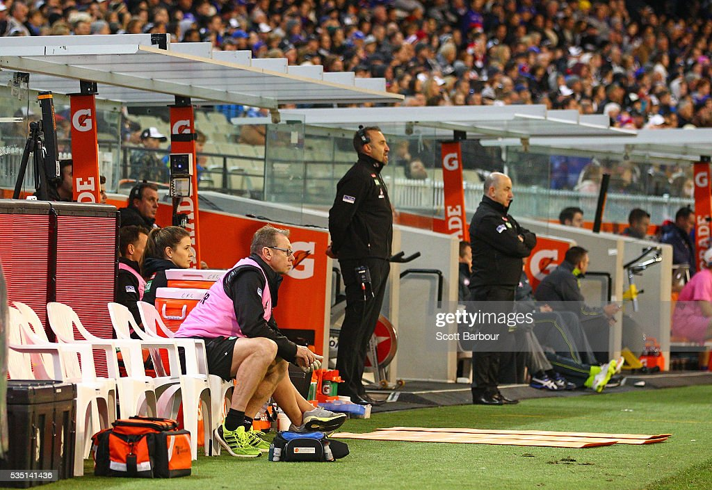 Members of the Magpies medical staff look on as the Magpies bench is empty during the fourth quarter during the round 10 AFL match between the Collingwood Magpies and the Western Bulldogs at Melbourne Cricket Ground on May 29, 2016 in Melbourne, Australia.