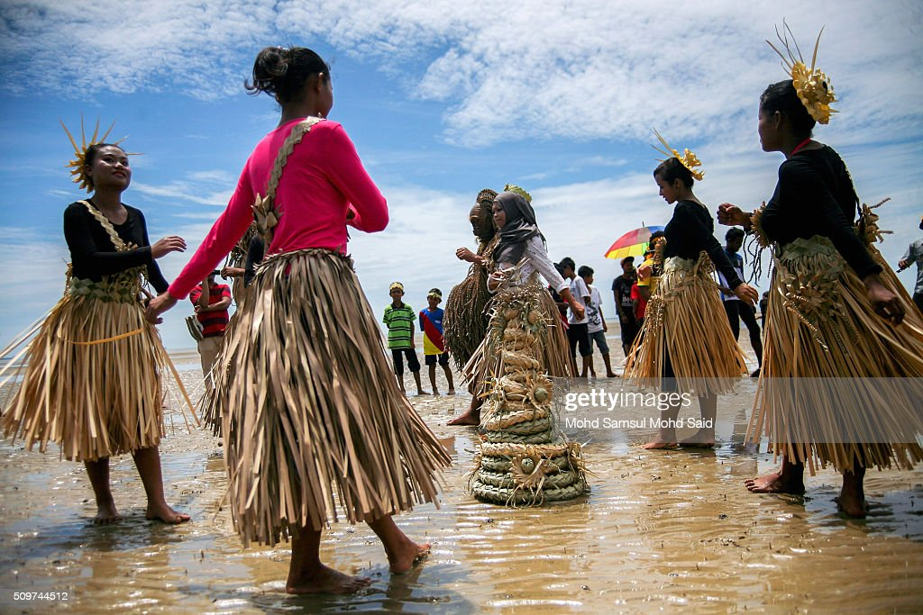 Members of the Mah Meri tribe perform the 'Main Jo-oh' dance, part of the Puja Pantai' rituals prayer (Puja Pantai), a thanksgiving ritual to appease the spirits of the seas at Pulau Carey, Straits of Malacca beach on February 12, 2016 in Pulau Carey, Malaysia. Every year, the indigenous people of Mah Meri village, located in Pulau Carey, about 140 km (87 miles) southwest of Kuala Lumpur, perform the 'Puja Pantai' ritual prayer and 'Main Jo-oh' dance to appease the spirits of the seas and celebrate the New Year.