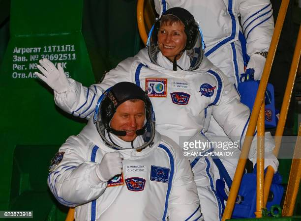 Members of the main crew of the 50/51 expedition to the International Space Station Russia's cosmonaut Oleg Novitsky and US astronaut Peggy Whitson...