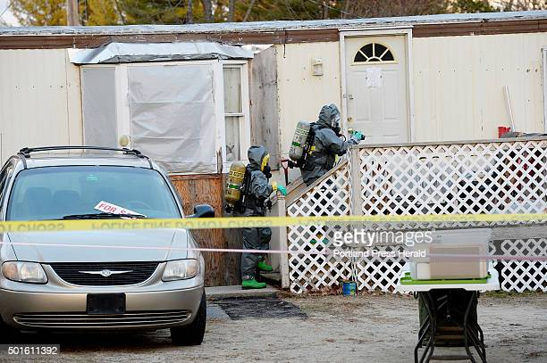 Members of the Maine Drug Enforcement Agency investigate a home at 125 Old Thompson Road in Buxton that is a possible methamphetamine lab Tuesday...
