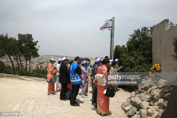 Members of the Makuya a mainly Christian Japanese movement supporter of the Israeli state attend a memorial ceremony for fallen Israeli soldiers at...