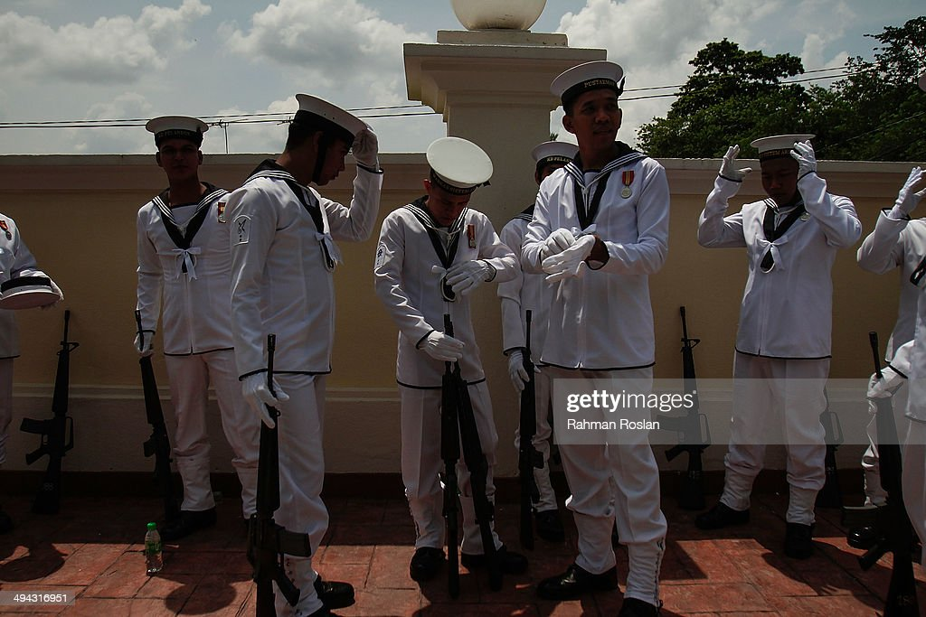 Members of the Malaysian Navy arrive to participate in Sultan Azlan Shah's royal burial ceremony on May 29 2014 in Kuala Kangsar Perak Malaysia...