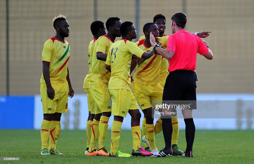 Members of the Mali team react as Lassana Coulibaly of Mali(not pictured) is sent off during the Toulon Tournament match between France and Mali at Stade Perruc on May 24, 2016 in Hyeres, France.