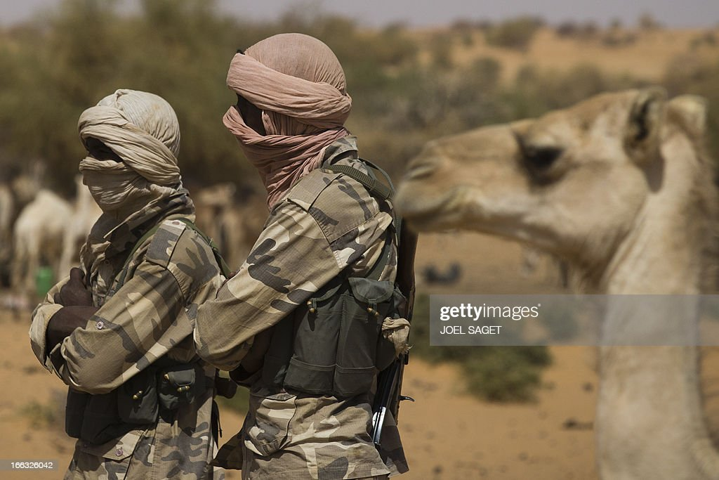 Members of the Malian Special Force are pictured on April 9, 2013, 105 kms north of the northeastern Malian city of Gao, during the Operation Gustav, a hunt for Islamist fighters in a valley in northern Mali and one of France's largest military operations during its three-month intervention in its former colony. Operation Gustav comes with France preparing to withdraw three-quarters of the 4,000 troops it deployed in January to block a feared advance on the Malian capital Bamako by Al Qaeda-linked insurgents.