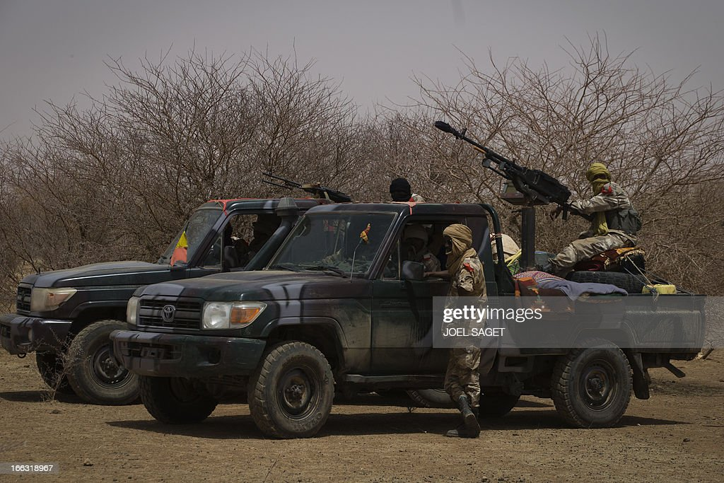 Members of the Malian special forces stand on an armed pick-up truck on April 10, 2013, 105 kms north of the northeastern Malian city of Gao, in day three of Operation Gustav, a hunt for Islamist fighters in a valley in northern Mali and one of France's largest military operations during its three-month intervention in its former colony. Operation Gustav comes with France preparing to withdraw three-quarters of the 4,000 troops it deployed in January to block a feared advance on the Malian capital Bamako by Al Qaeda-linked insurgents.