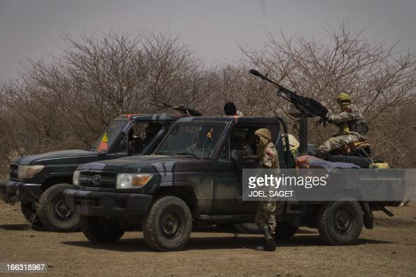 Members of the Malian special forces stand on an armed pickup truck on April 10 105 kms north of the northeastern Malian city of Gao in day three of...