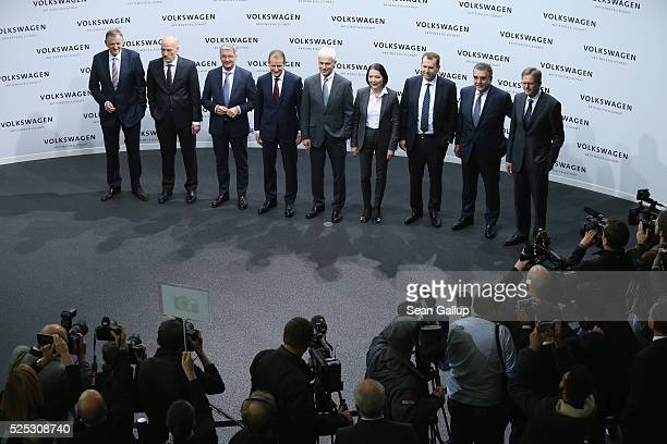 Members of the managing board of German automaker Volkswagen AG including CEO Matthias Mueller arrive for the comany's annual ppress conference on...