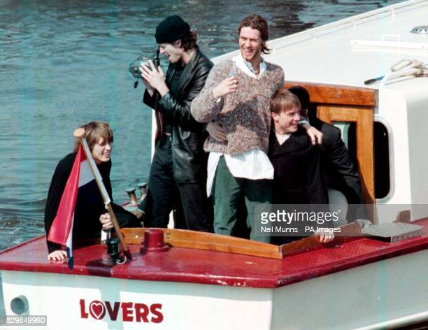 Members of the Manchester band Take That wave to the crowd from their launch after leaving the Amstel Hotel in Amsterdam today on their way to a film...