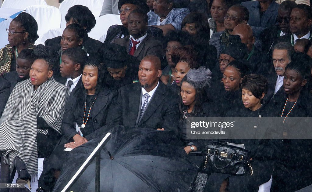 Members of the Mandela family, including grandson <a gi-track='captionPersonalityLinkClicked' href=/galleries/search?phrase=Mandla+Mandela&family=editorial&specificpeople=5849591 ng-click='$event.stopPropagation()'>Mandla Mandela</a> (C), attend the official memorial service for former South African President Nelson Mandela at FNB Stadium December 10, 2013 in Johannesburg, South Africa. Over 60 heads of state have travelled to South Africa to attend a week of events commemorating the life of former South African President Nelson Mandela. Mr Mandela passed away on the evening of December 5, 2013 at his home in Houghton at the age of 95. Mandela became South Africa's first black president in 1994 after spending 27 years in jail for his activism against apartheid in a racially-divided South Africa.Ê