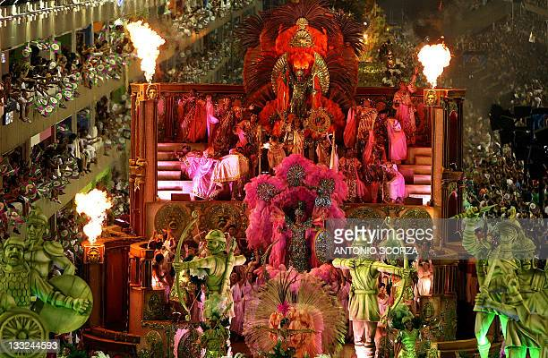 Members of the 'Mangueira' samba school perform a top of a float at the Sambadrome during carnival celebrations in Rio de Janeiro Brazil 18 February...