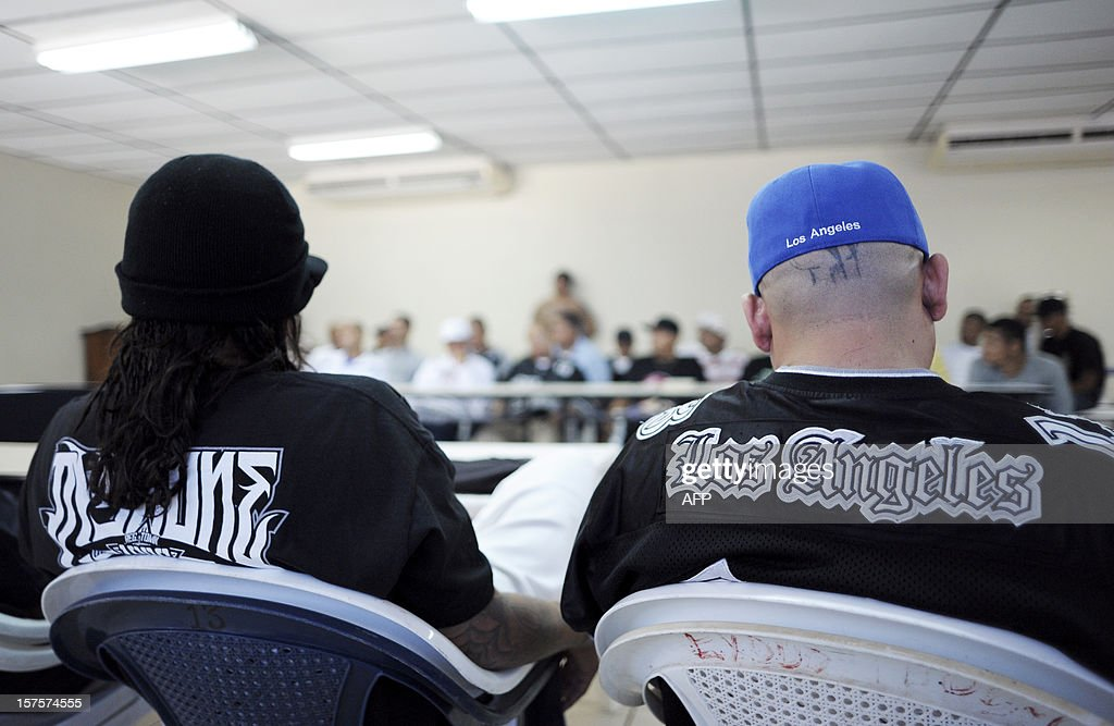 Members of the Mara Salvatrucha and the Mara 18 gang participate in a press conference with Salvadorean government mediators, at La Esperanza jail in San Salvador, El Salvador on December 4, 2012. Gang members announced the proposal to create sanctuary territories for gangs as a part of the truce started earlier this year. AFP PHOTO/Jose CABEZAS