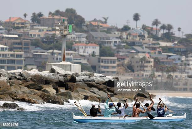 Members of the Marina Outrigger Canoe team paddle into the harbor on July 21 2008 in Marina Del Rey California