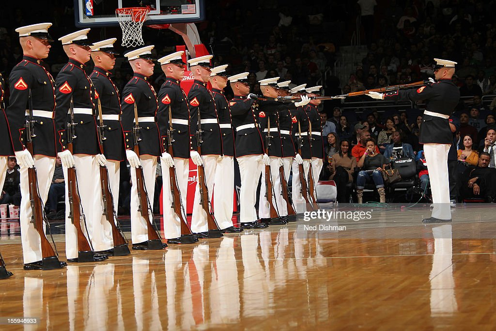 Members of the Marione Core Drill Team perform during half time at the Washington Wizards game against the Milwaukee Bucks during the game at the Verizon Center on November 9, 2012 in Washington, DC.