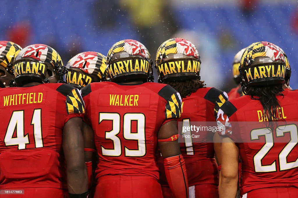 Members of the Maryland Terrapins huddle before a kick off during the second half against the West Virginia Mountaineers at M&T Bank Stadium on September 21, 2013 in Baltimore, Maryland. Maryland won 37-0.