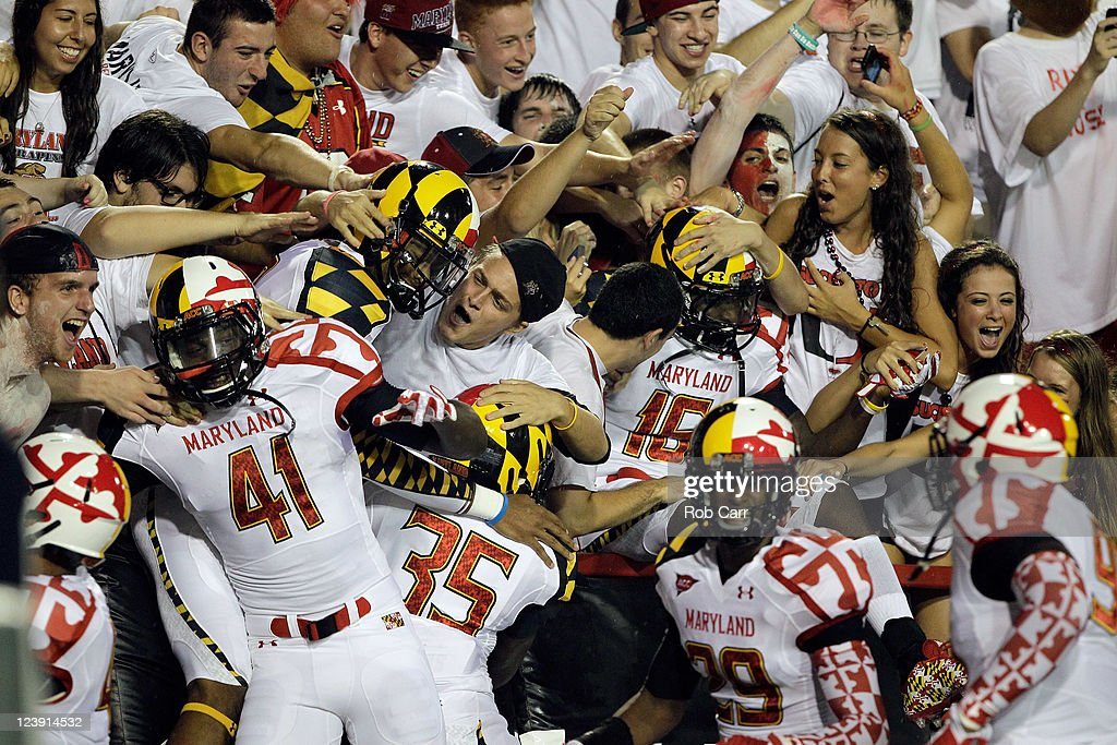 Members of the Maryland Terrapins jump into the student section before the start of the Terrapins game against the Miami Hurricanes at Byrd Stadium on September 5, 2011 in College Park, Maryland.