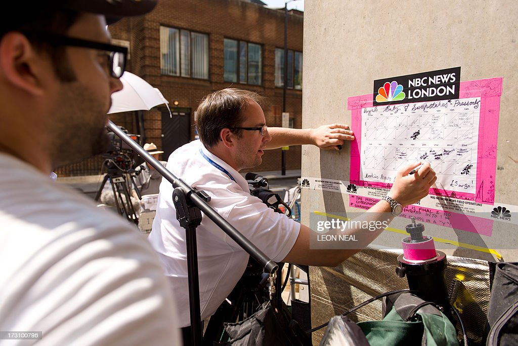 Members of the media add to a sweepstake on the royal baby's sex and arrival time outside the Lindo Wing of St Mary's hospital in London on July 7, 2013. Prince William and wife Catherine's first child is not officially due until mid-July but this hasn't stopped news organisations from setting up dozens of camera positions outside the private Lindo Wing of St Mary's Hospital, where William was born in 1982 and his brother Harry in 1984.