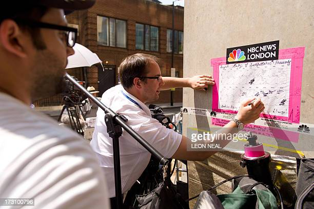 Members of the media add to a sweepstake on the royal baby's sex and arrival time outside the Lindo Wing of St Mary's hospital in London on July 7...