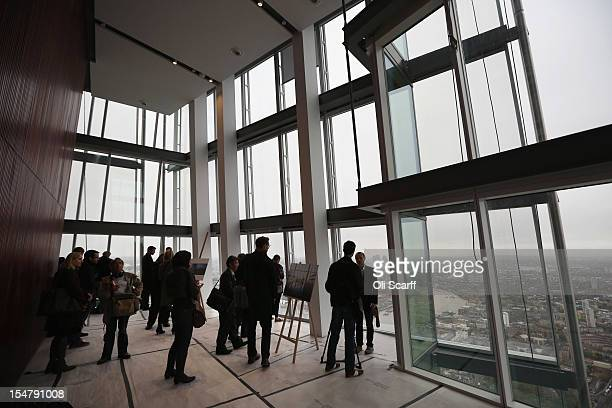Members of the media admire the view from the 69th floor of The Shard skyscraper on the preview day to mark the sale of tickets for the 'View from...
