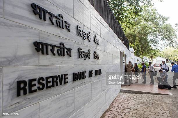 Members of the media and other attendees queue at the entrance to the reception of the Reserve Bank of India in Mumbai India on Tuesday June 7 2016...