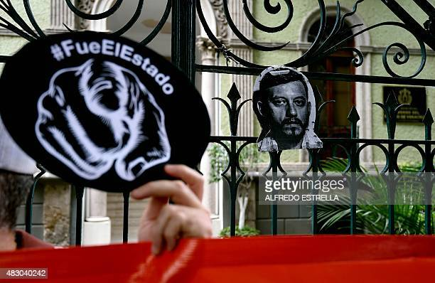 Members of the media and the civil society protest with banners against Veracruz governor Javier Duarte demanding justice in the murder of...